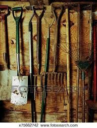 stock image gardening tools hanging on shed wall fotosearch