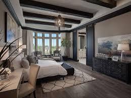 Luxury Mediterranean Style Bedroom With Wide Plank Wood Flooring And  Exposed Wood Beams