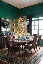 emerald dining room with blue and white ginger jars beautiful white ginger