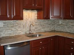 kitchen backsplash ideas with white cabinets black high gloss wood countertops red four small pendant lamp