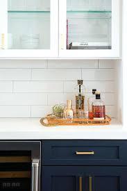 white quartz backsplash white quartz kitchen collection white and blue kitchen features navy blue shaker cabinets adorned white quartz countertop backsplash
