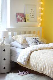 Add a splash of colour to kids bedrooms with a statement wall and bedding  to compliment