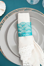 use your cricut explore to make this darling scallop charger and napkin ring set perfect