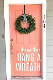 how to hang a wreath on doors