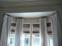 how to hang curtains in a bay window window curtain how do you hang curtains in