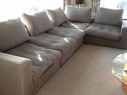 l shaped 5 seater sofa in grey fabric with cushions