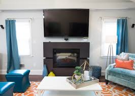 we replaced a blah brick fireplace with this contemporary split feature property brothers season 6 episode 13