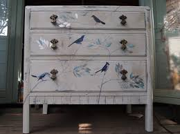Vintage chest of drawers painted in white, distressed and stained to age  it. Decorated