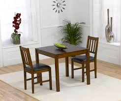 mark harris marbella solid dark oak dining table with 2 chair