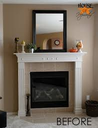 a dramatic fireplace makeover white moulding black mantel