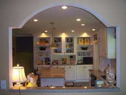 unique wall cut out to open kitchen into dinning room from white kitchen and breakfast room