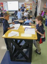 students from barth elementary school in pottstown complete worksheets while standing at an elevated workstation