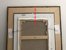 the red line indicates the measurement from a tightened hanging wire to the top of the frame