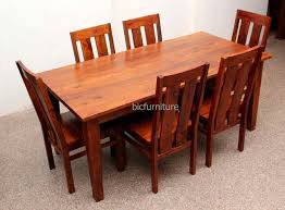 six seater solid wood dining table