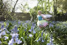 stock photo young girl 5 6 running in flower garden wearing fairy costume motion blur