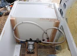 water tank in forward part of bed enclosure