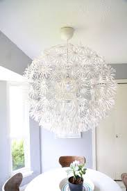 ikea flower light hanging in kitchen breakfast nook