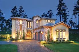 contemporary exterior lighting. contemporary exterior of home with partial stone wall, arched double entry door, tile lighting p