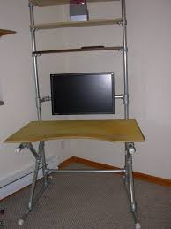 picture of spacing the shelves mounting the desk top adding the monitor