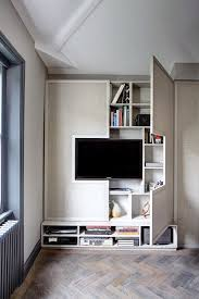 Wall of storage in a small space - incorporating media storage. Image  houseandgarden.co