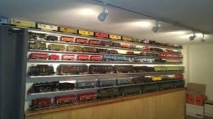 most of my standard gauge is on the walls using aluminum shelves made by wachtman of trainshelf my layout has a single loop of standard gauge track