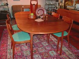 mid century modern danish dining table and 4 chairs table is round and