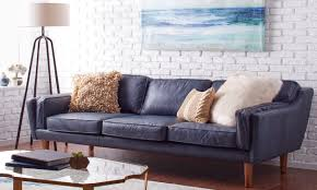 blue leather sofa in a living room