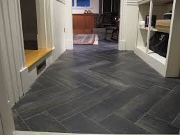 herringbone tile floor. Wonderful Grey Porcelain Wood Herringbone Tile Floor And White Open Cabinetry Shelves Also Wainscoting In Entryway Decors Tips B