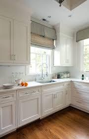 transitional kitchen lighting. Built In Transitional Kitchen With Faucets Also Ceiling Lighting And Roman Shades Tile Backsplash Wood Floors Plus Double Hung F