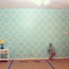 My mint green bedroom accent wall. Freehand painted.