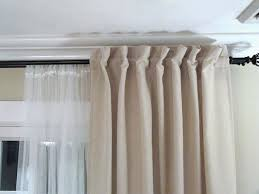 tab top curtain to back tab