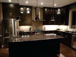 dark kitchen cabinets and countertops espresso cabinets and grey brown granite love this for a bright