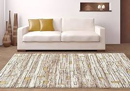 modern geometric area rug shades of beige cream with gold accents