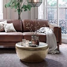 Perfect for style and function in a living area, study or entryway. Hammered Metal Drum Coffee Table