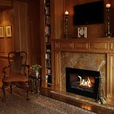 image of stunning log cabin interior wall panel with log cabin fireplace mantels also two story log home designs log cabin stove log cabin themed