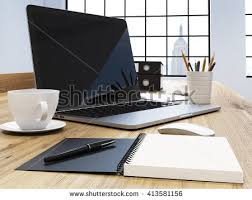 items for office desk. Sideview Of Office Desk With Blank Laptop Screen, Coffee Cup, Other Items And For