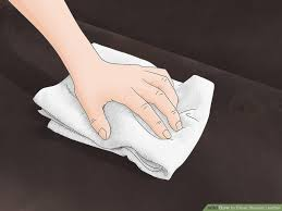 remove stains from leather bags with towel