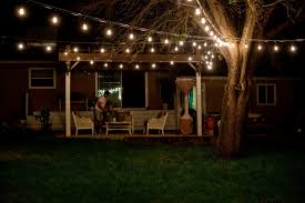 outdoor round patio string lights on a tree add ambience to any outdoor gathering perfect for outdoor weddings graduation parties or casual dinner