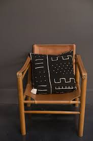 leather safari chair and mud cloth pillow