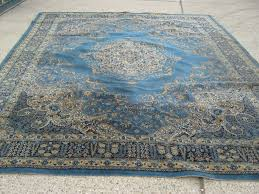 a large persian blue ground wool rug