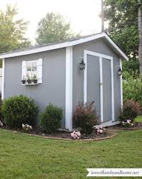 backyard shed decorating ideas cute shed like the lanterns and the shutters