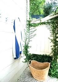 pool towel hook outdoor shower area with whitewashed siding accented boat dock hooks over swimming design