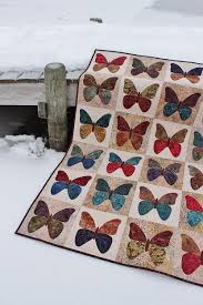 Tamarack Shack: Butterflies Quilt Done! & Back in October I shared a post here on my Butterflies quilt and this week  I was able to quilt it up and even get the binding on! Adamdwight.com