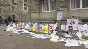 Image result for Protesters are leaving signs outside #TrumpHotel