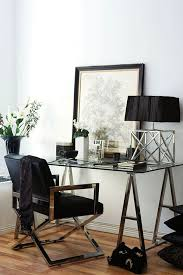 glass top office table chic. stylish metal leg and a glass top desk looks very masculine office table chic