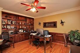 office paneling. traditional home office with hardwood floors ceiling fan builtin bookshelf wainscoting paneling