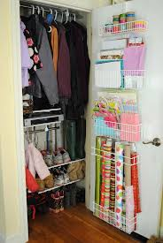 Hall closet door wrapping paper and gift bag storage