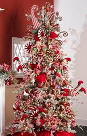 Candy cane Christmas tree. What a clever item. You could also add Santa  Claus ornaments to complete the theme.   Holiday crafts and food    Pinterest ...