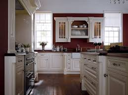 White cabinets and moldings contrast perfectly with burgundy or ...