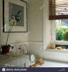 Traditional White Bathrooms Picture On Wall Above Bath In Traditional White Bathroom With